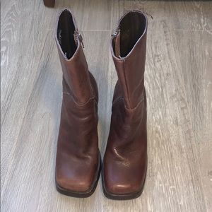 High heeled mid-shin brown boots